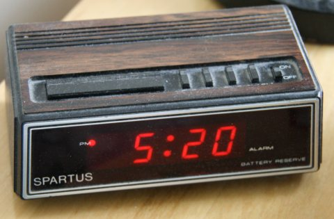 Basic alarm clock, large LED segmented display, buttons on top.